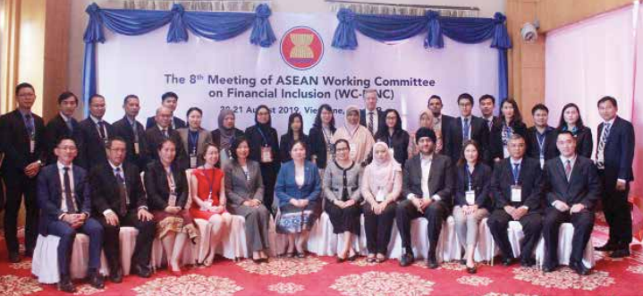 The Deputy Governor of the Bank of the Lao PDR, Mrs Vatthana Dalaloy (seated, centre), seen with other members of the Asean Working Committee on Financial Inclusion in Vientiane yesterday