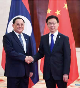 Chinese Vice Premier Han Zheng (right) meets with Lao Deputy Prime Minister Sonexay Siphandone during the 16th China-Association of Southeast Asian Nations (Asean) Expo in Nanning on September 20, 2019. --Photo Xinhua