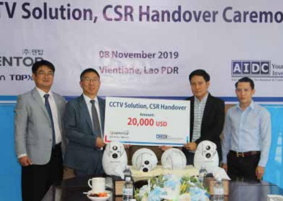 Mr Hong-Dae Park (second left) hands over a CCTV system to Mr Souliya Ackhasone.