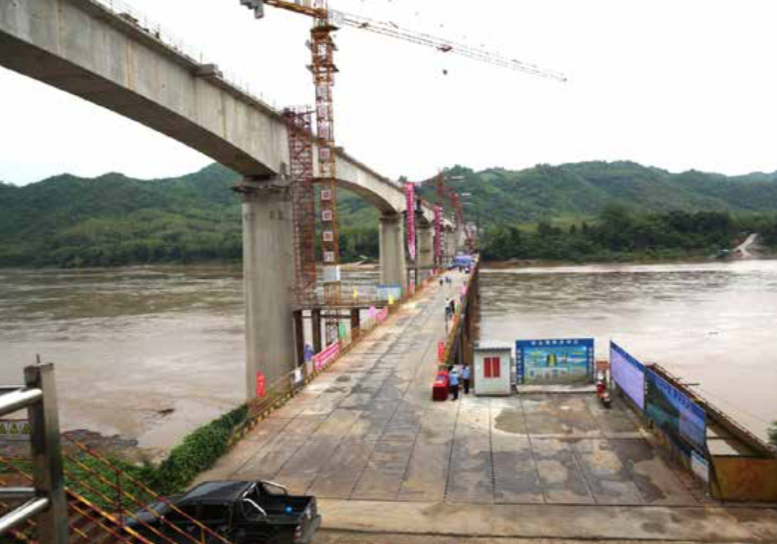 This bridge across the Mekong in Luang Prabang will carry the Laos-China railway. --Photo Khamphan