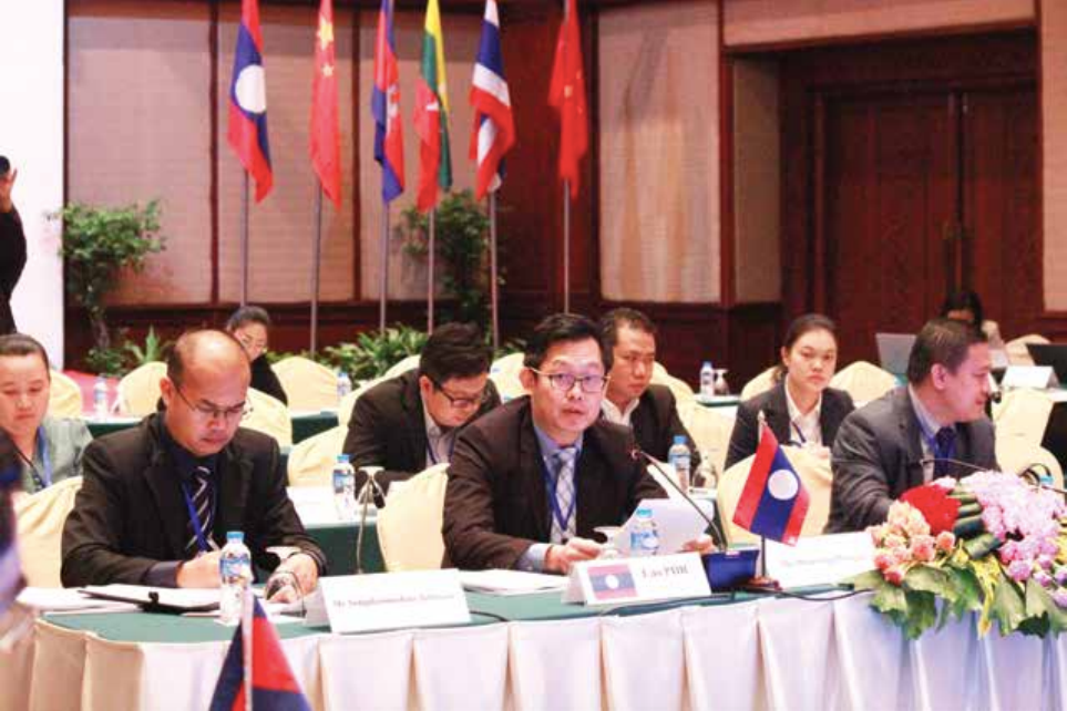 Acting Director General of the Planning and Cooperation Department under the Ministry of Industry and Commerce, Mr Phouvieng Phongsa (centre) addresses the meeting in Vientiane yesterday.