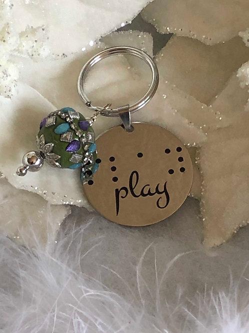 "Braille key chain/cane tag  ""play"""
