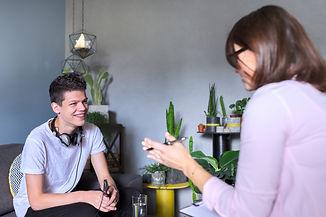 Teen boy talking to professional psychol