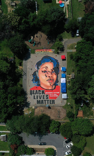 Artists and volunteers descended on a basketball court in a historically Black neighborhood of Annapolis, Maryland, to paint a 7,000-square-foot mural of Breonna Taylor over the Fourth of July weekend. The project was led by Annapolis-based Future History Now, a nonprofit art collective that creates murals with youth facing adversity in underserved communities. Taylor's death has become another flashpoint in national demonstrations over police brutality. She was killed in March by three Louisville, Kentucky, Metropolitan Police Department officers during the execution of a no-knock warrant.Patrick Smith/Getty Images