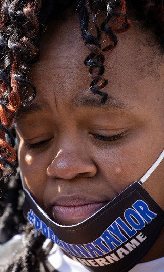 Tamika Palmer, the mother of Breonna Taylor, closes her eyes during a vigil for her daughter in Louisville, Kentucky, on June 6.Brett Carlsen/Getty Images