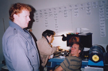 Animators Owen Klatte and Angie Glocka go over a shot with Stan at the flatbed.