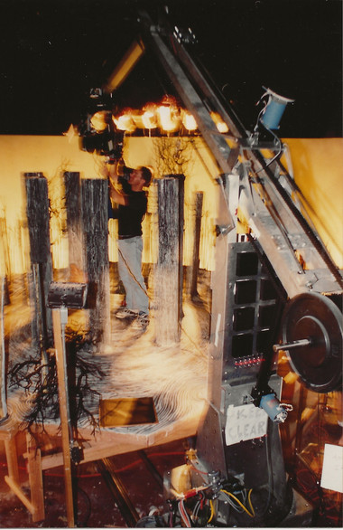 Carl standing on set adjusting the Mitchel camera. Note the size of the motion control rig the camera is attached to. This was one of the bigger rigs at Skellington.