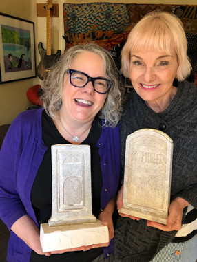 Gisela & Kat with their tombstones from the graveyard sequence.