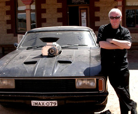 Deane was sure to send us this picture of him with the car from Mad Max because Todd always made him quote lines from The Road Warrior.