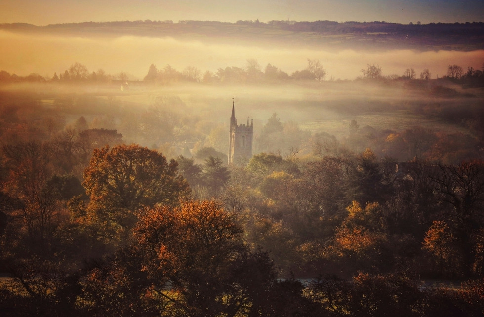 St. Andrew's Church and autumnal mist