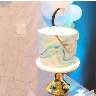 marble cake with gold geometric design