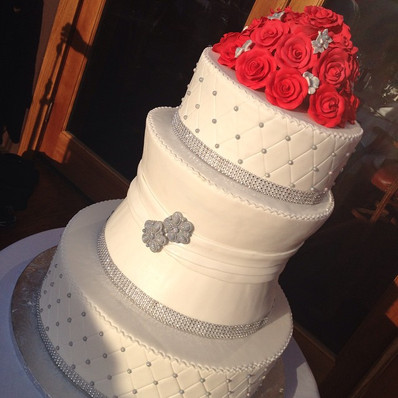 Bling wedding cake with red sugar rose topper