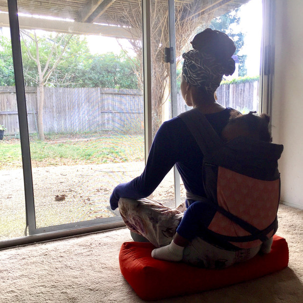 Kavisa Nourishing Justly - Meditating while her toddler sleeps in a baby carrier