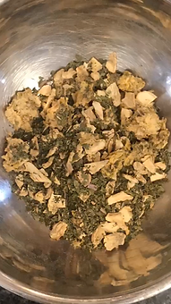Close up photo of dried herbs featuring ginger and dandelion leaf