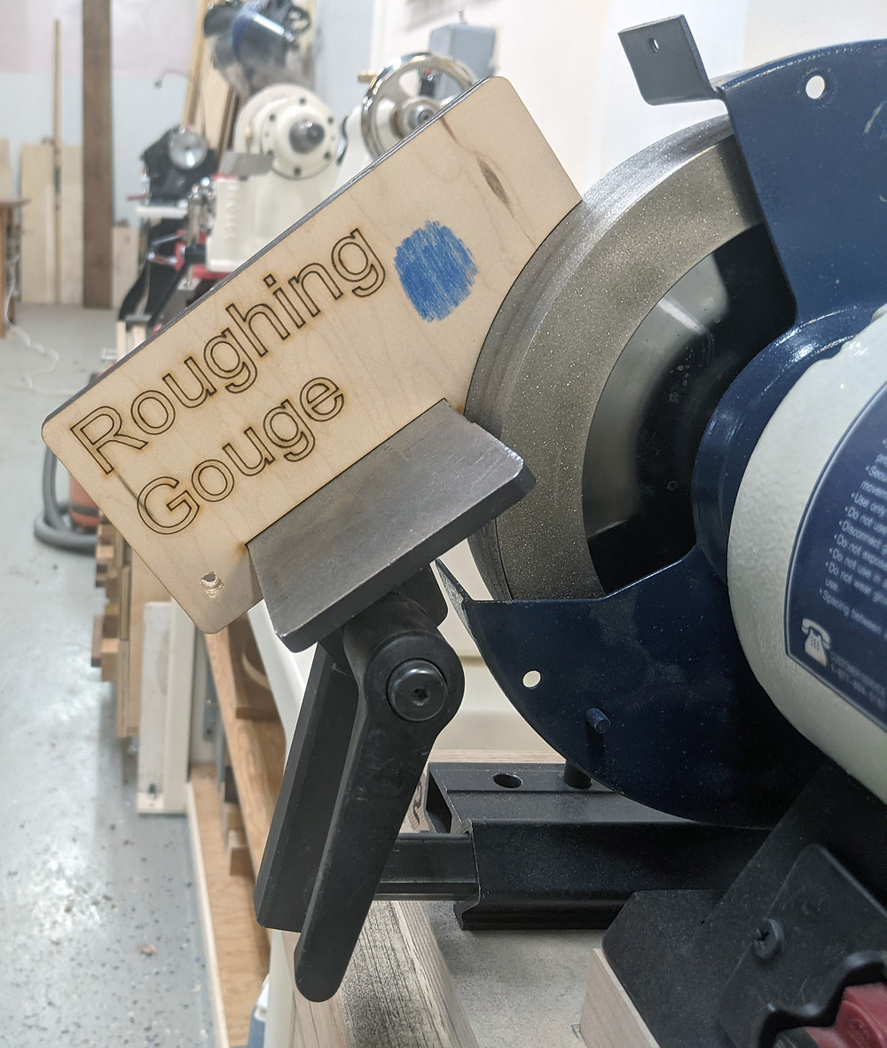 A laser cut plywood tool sharpening jig used to set the angle of a tool rest