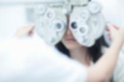 Woman getting eye exam