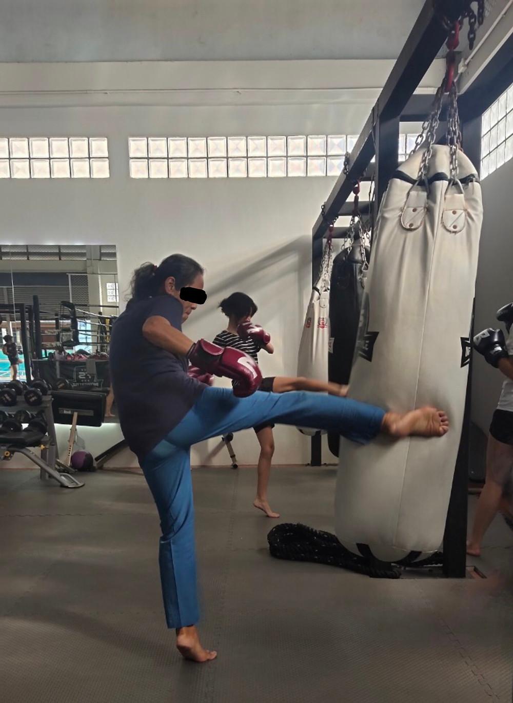 Women kicking a punchbag - Break the Silence group