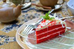 Red Velvet Cake With Cup Of Tea And Kettle