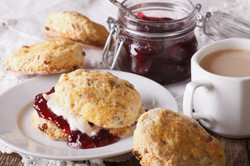 Delicious English Scones With Jam And Tea With Milk Close-up. Horizontal