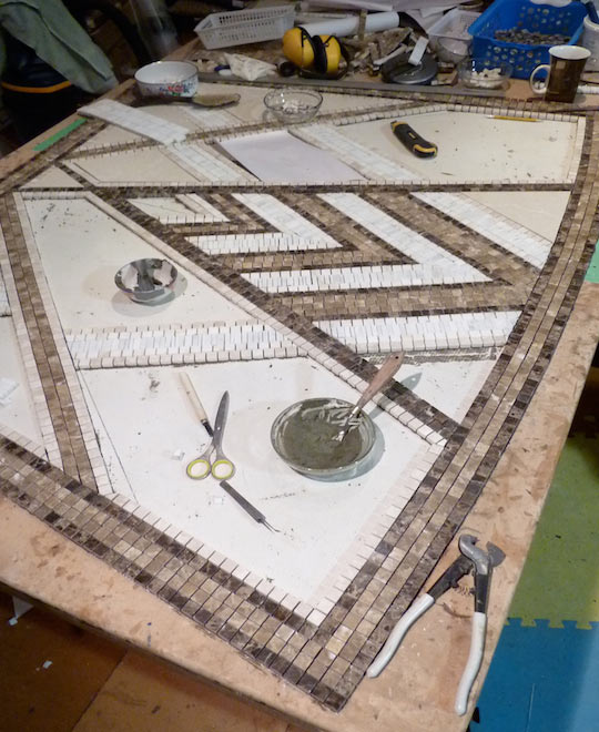 Mosaic marble inlay in fabricaton