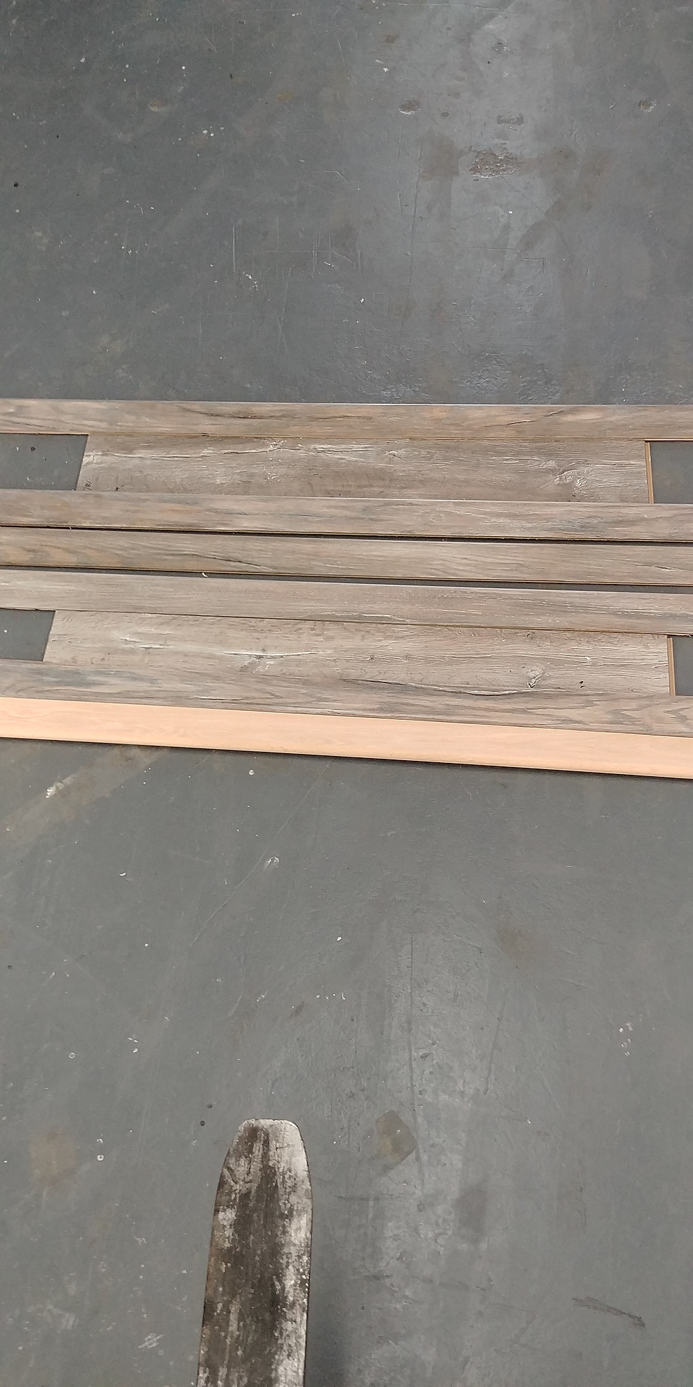 Red Oak stair nose finished in house to blend with rustic laminate flooring