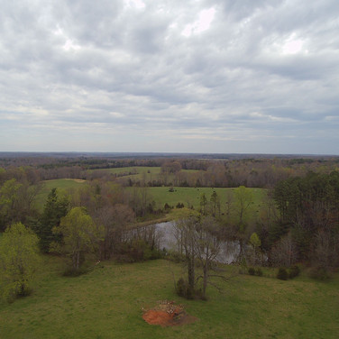 Drone shot of pond from a distance