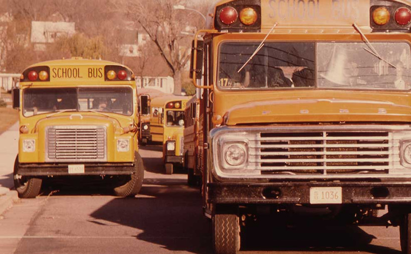 Students-arriving-by-school-bus-in-early