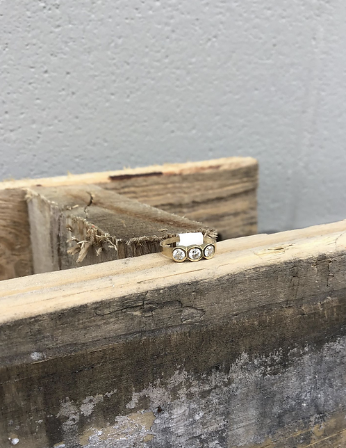 Size 1 Baby Ring in 10K Yellow Gold with 3 CZs Bezeled