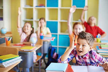 children-classroom-with-theirs-hands-up.