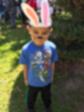 Boy w_ bunny ears.JPG