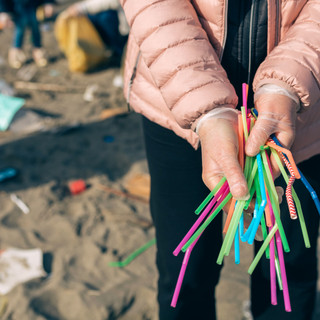 Canva - Woman Showing Handful of Straws