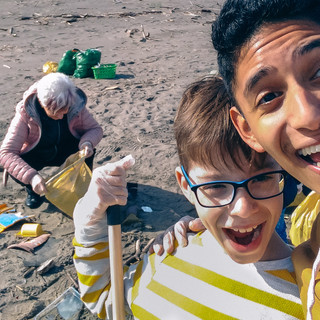 Canva - Young Man and Boy Taking Selfie