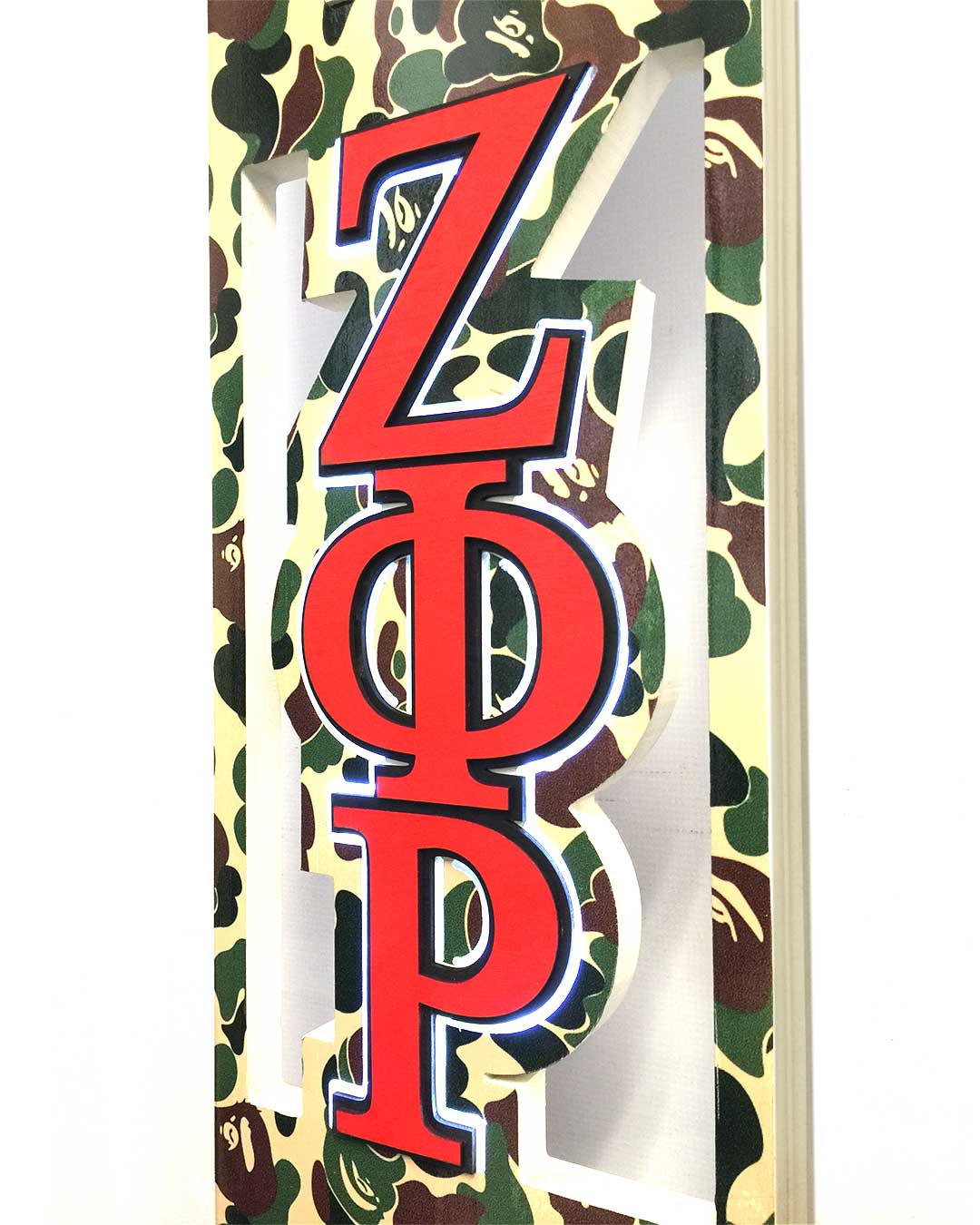 greek paddle with camo print