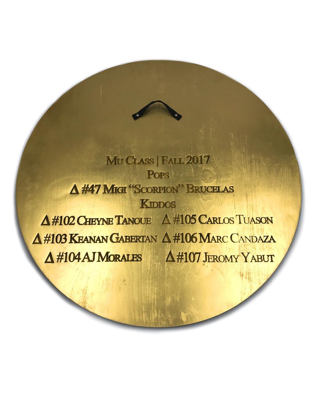 back of gold circle greek paddle