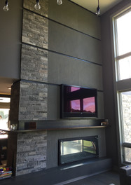 Floor-to-ceiling textured granite firepl