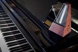 Wooden metronome on a grand piano