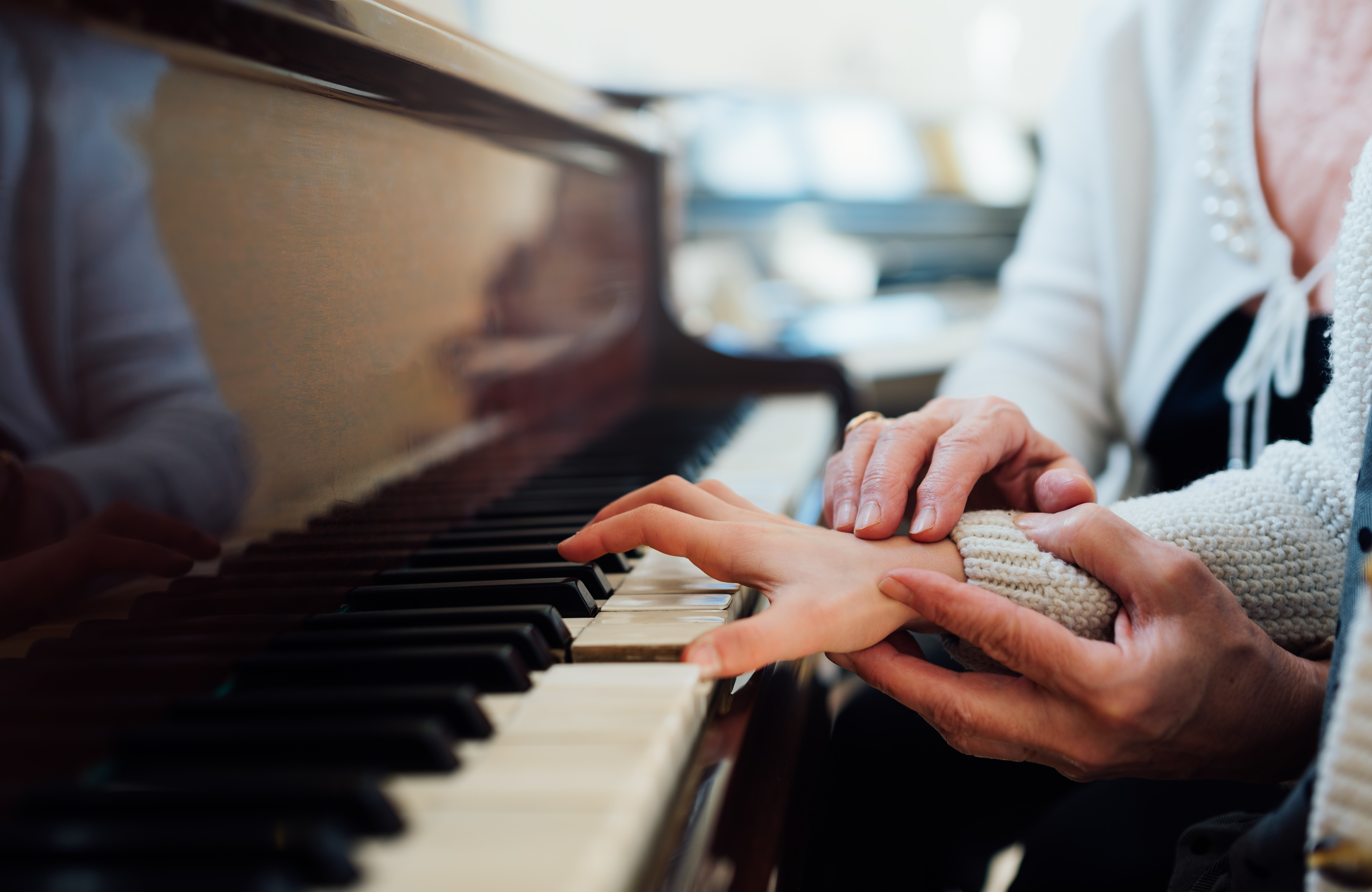 experienced hand of the old music teache