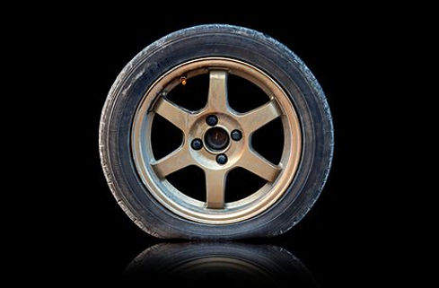 Flat tire isolated from Black background