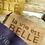 Thumbnail: POCHETTE BANDOULIERE LA VIE EST BELLE TAUPE - Shacof