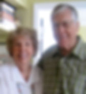 Interiors for seniors clients Meg & Bill smiling after a move