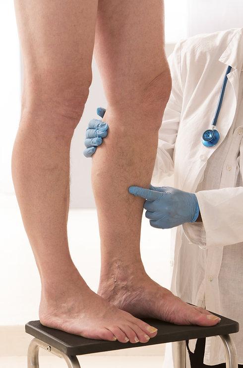 Doctor-checking-legs.jpg