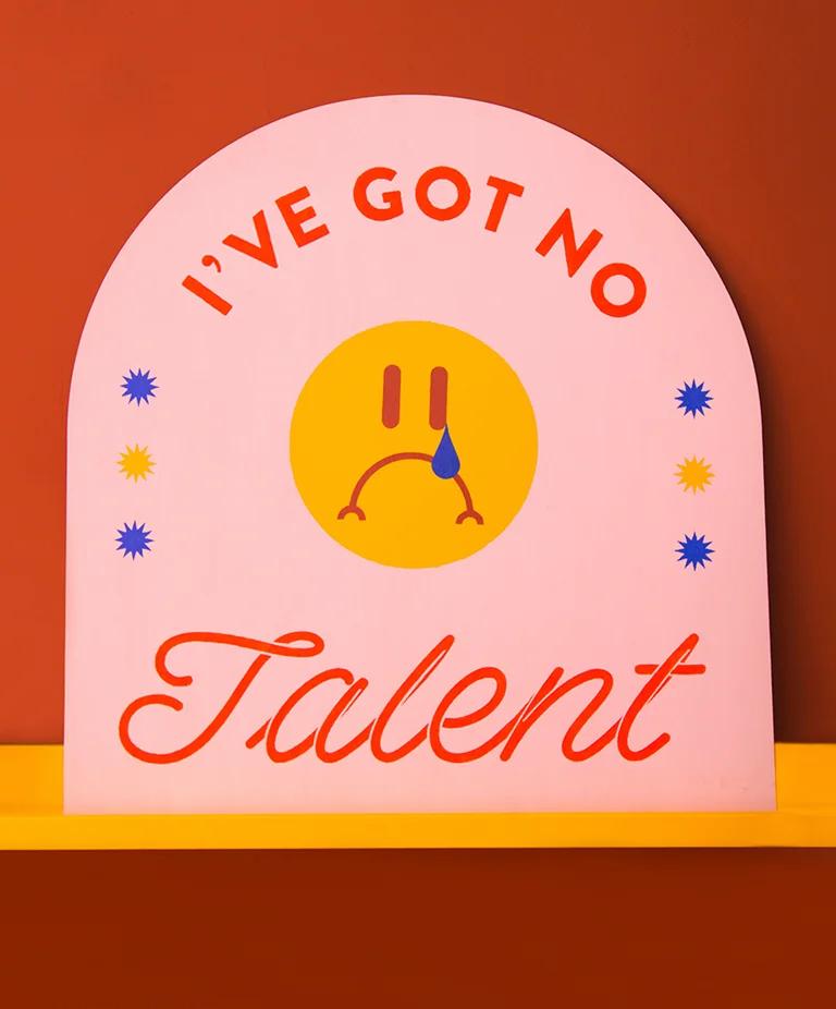 Colorful sign saying 'I've got no talent'