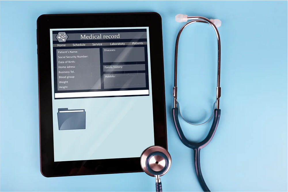 Healthcare app on tablet next to stethoscope