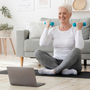 Sporty older lady training online at home