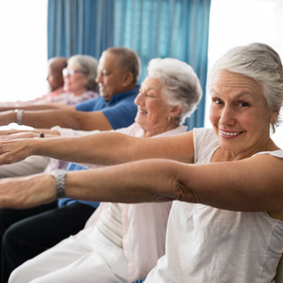 Portrait of smiling senior woman exercise group fitness class