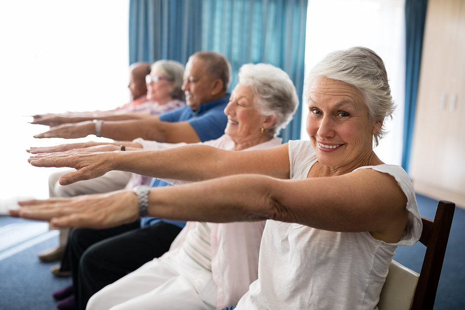 Portrait of smiling senior woman exercis