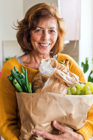 older woman holding groceries_small.jpg