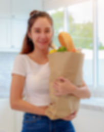 stock crop young woman with groceries.jp
