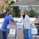 Volunteers filling boxes.jpg