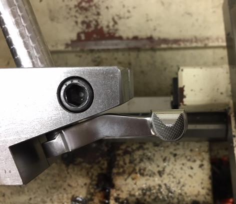 Starting to turn down a bolt knob.